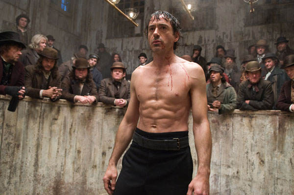 Robert Downey, Jr shirtless as Sherlock Holmes in a fist fight