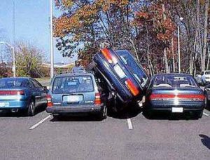 3 cars squeeze into 2 parking spaces